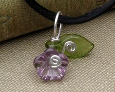 Sweet and small and we have matching earrings in our Etsy shop too-  Little Lilac Purple Glass Flower Pendant by nicholasandfelice, $ 8.50