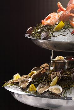 Oysters anyone? Stop by Comme Ca's Happy Hour for 50% off 18A cocktails & select food from 5-7pm all weekend