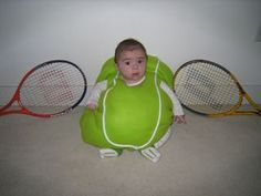 Tiny tennis ball. So cute!...poor kid will hate this picture when he is older..Lol