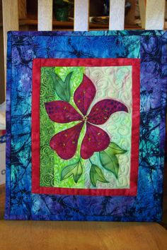 Clematis art quilt wallhanging, appliqued flower and leaves, batik fabrics, beads and paint. Raw-edge applique technique. This is a 10 x 12 quilted
