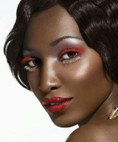 Very editorial but red makeup looks great on this skin tone.