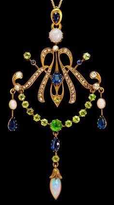 Art Nouveau Antique Russian Jeweled Gold Pendant. circa 1900,    14K gold, 14 Russian Uralian demantoids, 6 sapphires, 4 opals, 44 rose-cut diamonds, and 5 diamonds in various cuts.  Height - 3 3/4 in. (9,4 cm). Width - 1 3/4 in. (4,7 cm).