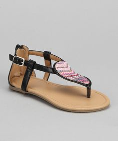 When the sun comes up, sandals come out to play! Plan for days greeted by warm rays with this colorful chevron pair. An adjustable buckle details the faux leather strap, providing a secure fit for every step.Buckle closureMan-madeImported