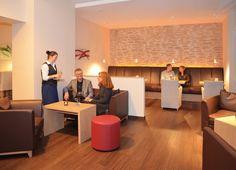 Genießen Sie das moderne und gemütliche Ambiente unserer Lounge