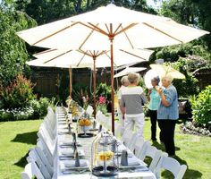 long table setup inspiration (like the umbrellas for shade)