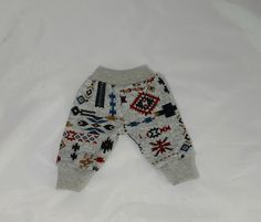 """All bibdanas and pants are buy 3 get 1 free of equal or lesser value. You can mix and match!  Add 3 bibdanas and/or pants to your cart and leave """"note to seller"""" letting me know the 4th item of equal or lesser value you would like and it will be included in your shipment.     These adorable pants are made of knit fabric and the legs and waistband are made of ribbed knit.   These pants are made to fit average sized babies and toddlers and fit true to size to slightly baggy. Pattern place..."""