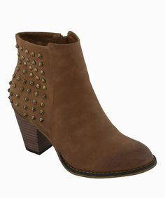 A grid of studs brings a high-profile kick to this low-lying boot. Lifted by a walkable heel, this boot is a fabulous everyday style pick.