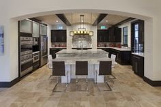 The Kitchen in Villa Sirena, an Orlando Custom Home that is a blend of Spanish Mission Architecture and Contemporary design elements by Orlando Custom Home Builder Jorge Ulibarri of Cornerstone Custom Construction