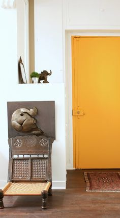 The Caribbean yellow front door to a Paris pied-a-terre updated by Ishka Designs of Brooklyn | Remodelista