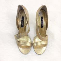 Nina Gold Heels These shoes are made of leather and like new. They were only worn once. The shoes do not have any stains or defects. Nina Shoes Heels