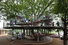 A kindergarten in Tachikawa, Japan, by Tezuka Architects built around a Zelkova tree that has see-through classrooms and play areas.