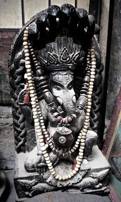 Ganesh statue in a dusty antique shop, Kathmandu.