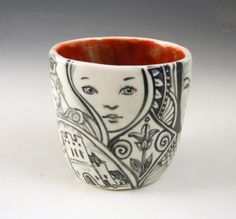 This is a slightly larger hand made black and white One of a kind porcelain tea bowl or cup with lots to look at- a king, castle,baby, mysterious woman etc. It is 3 by 3 and holds about 7 ounces. The interior is a lovely rust and all glazes are lead free and food safe