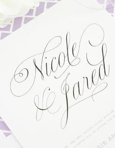 Wedding invitations with pretty script names and purple accents!