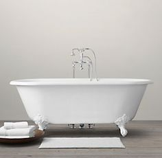 White tub with legs...love the faucet too