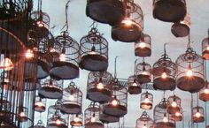 Lights made from re-purposed antique bird cages. Grouping is great for lighting.