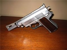 .Wildey Mag This large, odd looking semi-auto pistol was designed to handle extreme magnum loads. Operating with rotating bolt, piston and adjustable gas system, it can be fine tuned to specific factory or handloads. Large caliber semi-auto handguns were competing against each other in the late 80′s; Wildey, AMT Automag, LAR Grizzly and Desert Eagle were among the best known, but only the Desert Eagle remains in production today.