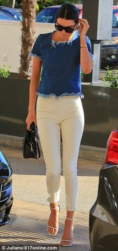 Kendall Jenner displays thin pins in white skinnies and stilettos #dailymail