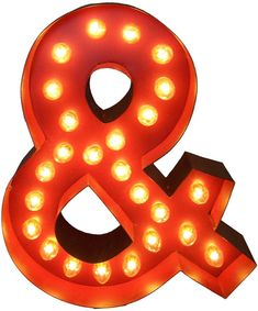 Awesome Whimsical lighted carousel ampersand symbol.  includes lights, a teeny assembly process.  safe for outdoor or indoor use!