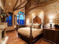 Perfect blend of rustic & luxury with a stone arch inset for the bed...
