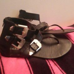 Black sandals w/silver buckles Very cute ankle high black sandles, zipper back, buckle accents on side, thong style. Only worn one time, excellent condition Deb Shoes Sandals