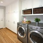 Love the storage cabinets in this laundry room