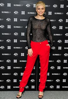Jessie J shows off her toned physique in sheer long-sleeved top and red trousers before switching on . Jessie J Singer, Jessi J, Girls With Shaved Heads, Sweet Talker, Red Trousers, Hair Flip, Oxford Street, American Music Awards, Celebs