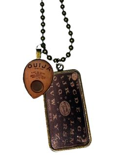 Women's necklace with a small ouija board and planchette by Se7en Deadly