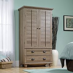 Garment hanging rod and storage cubbyholes behind louver detailed doors which fold back against end panels. Accommodates up to a 32 in. TV weighing 50 lbs. or less. Two drawers with metal runners and safety stops feature patented T-lock assembly system. Detailing includes solid wood, turned feet. Salt Oak finish.