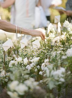 """wildflower """"bed"""" with escort cards"""