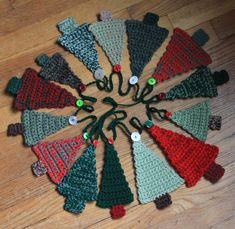 In addition to the icicle boy and girl ornaments I have another Christmas project to share; a garland of Christmas trees. I made my garland to hang across 2 windows but it could hang on the wall or… Crochet Christmas Garland, Christmas Bunting, Christmas Crochet Patterns, Holiday Crochet, Handmade Christmas Decorations, Christmas Knitting, Christmas Tree Ornaments, Christmas Poster, Crochet Tree