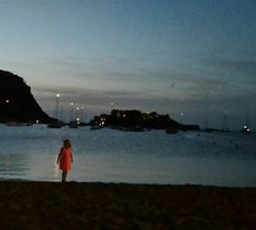 Katie on the beach at dusk at San Miguel Beach Club in Ibiza