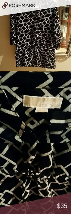 Michael kors black print tunic blouse Adorable cinch waist,  3/4 sleeves. Adorable with leggings, jeans or dress slacks. Very versatile excellent condition. Like new .last reduction. Tops Blouses