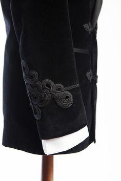 Detail shot of the trim on a black velvet smoking jacket.