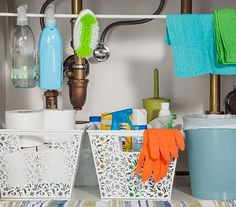 Keep your bathroom clean and tidy with Tension rods and Vinea storage baskets. Store them underneath your bathroom sink using that space efficiently by placing all the toiletries such as soaps, large bottles, solvent bottles, detergents, scrubs and toilet papers comfortably organized in these tools as directed in the pic. I liked that hanging bottle idea on the Tension rod. Isn't it unique?
