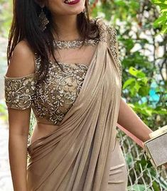 Latest Cold Shoulders Blouse Designs Cold shoulder saree blouse design is a stunning combination for parties, festivals and wedding wear. Traditional Indian attire makes women elegant and breathtaking. To team up with the sarees, lehe… Netted Blouse Designs, Fancy Blouse Designs, Bridal Blouse Designs, Blouse Neck Designs, Latest Blouse Designs, Golden Blouse Designs, Blouse Designs Lehenga, Latest Blouse Patterns, Lehenga Designs Latest