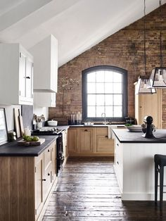 brick wall adds depth to kitchen. Great for mountain home