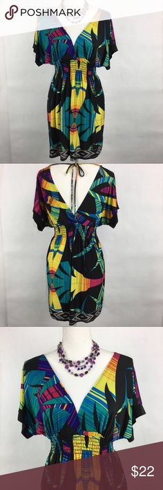 Abstract palm tree dress Abstract palm tree dress. V neck in front and back. Tie across the top of the back. Gathered waist. Trac size medium. 92% polyester 8% spandex. Trac Dresses