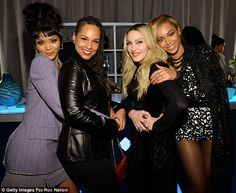 Fabulous foursome: Rihanna, Alicia Keys, Madonna and Beyonce had fun together as they cuddled up for a snap while backstage at the Tidal launch 30.03.2015