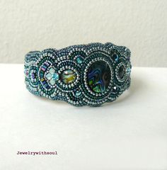 Bead embroidery  cuff bracelet with paua abalone cabochons, crystals and seed beads in rainbow peacock green blue teal and silver - Medusa.