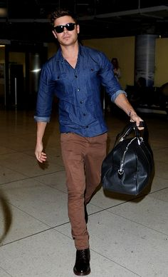 Zac Efron with the button up and brown pants, good combo.