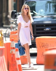 Heels? Psshh! Here Are 4 Ways to Rock Your Dresses With Sneakers