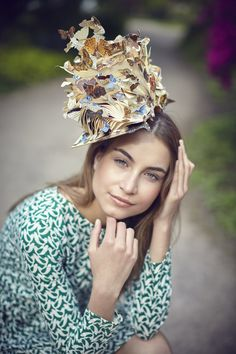 People Tree. Where Did You Get That Hat? Model wears Ora Kiely Birdwatch Organic Dress with Butterfly Book Hat. via Ethical Hedonist Magazine.