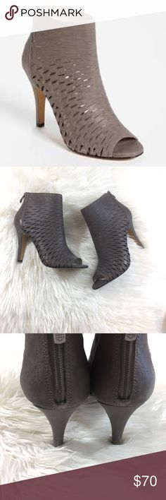 "Vince Camuto caged leather perforated booties NWOT Awesome never worn outside,  VC caged booties. Excellent condition, with only a few small marks on the leather as seen in pics. Gorgeous taupe color will go with everything. Heel is a little over 4"", no trades. Vince Camuto Shoes"