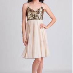 "Gold and cream dress Make an entrance in this stunning dress designed with a gold-toned sequined bodice and a cream-hued pleated skirt. Perfected with a flattering surplice neckline and adjustable straps, this swingy dress can be paired with a faux fur coat and ankle strap heels for a holiday party. Hidden side zipper closure. Fully lined.  100% Polyester Imported 30"" bust 37"" length from top Alythea Dresses"