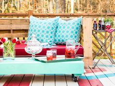 Bring rustic, repurposed charm to your deck or porch with shipping pallets and cushions.