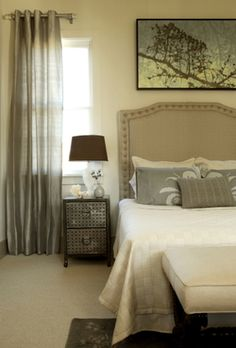 lovely bedroom done in warm neutral colors.  Really like the art on the wall.