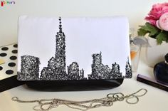 "New York purse, Statement bag, Black and white clutch, Hand painted handbag, Faux leather purse, Fabric and leather clutch, Wearable art by VictorsBoutique This handmade black and white clutch features New York city silhouette and it's called ""Foggy City"".This purse is hand-painted with special permanent water based textile paints (I only use Italian Maimeri products). For painting I used shades of black, gray and white on a white cotton piece of fabric. The body of the clutch is made of…"