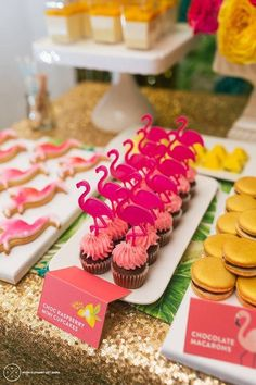 Dress up your tropical dessert display with chocolate raspberry cupcakes topped with flamingos! The gold sequin table cloth makes this area a statement piece!