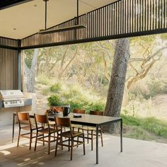 The dining room of this house, in a suburb of Silicon Valley, is designed so that it is always open to the outdoors and frames a large oak tree. Live Oak Trees, Internal Courtyard, American Houses, Street House, Tall Ceilings, California Homes, Outdoor Areas, Outdoor Rooms, Arquitetura
